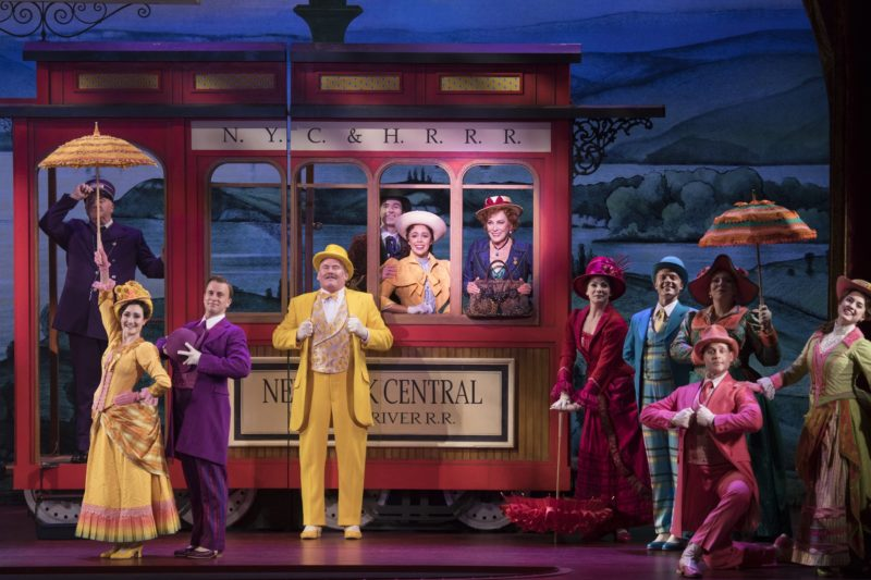 """Cornelius, Barnaby, Ambrose, Ermengarde and Dolly board the train to New York in the musical number """"Put On Your Sunday Clothes""""."""