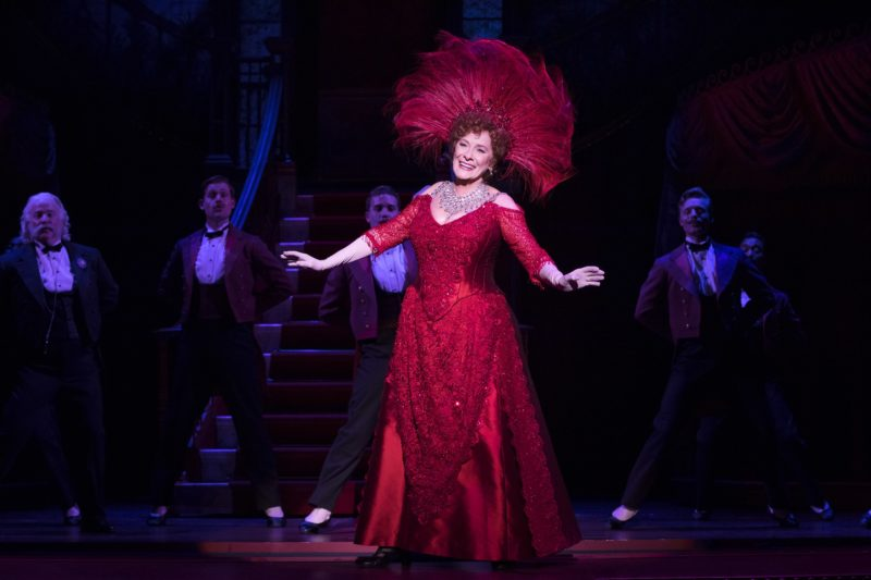 """Betty Buckley as Dolly, dressed in a stunning red dress, performs the show-stopping number """"Hello, Dolly."""""""